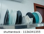 white plates on a shelf in a... | Shutterstock . vector #1136341355