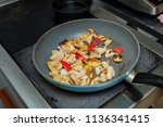 in the frying pan the cook... | Shutterstock . vector #1136341415