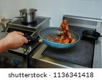 in the frying pan the cook... | Shutterstock . vector #1136341418