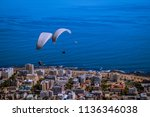 paragliders over the city of... | Shutterstock . vector #1136346038