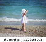 cute baby toddler girl on the... | Shutterstock . vector #1136355095