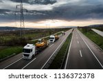 tow trucks in a convoy or... | Shutterstock . vector #1136372378