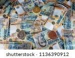 a golden litecoin  a copper...   Shutterstock . vector #1136390912
