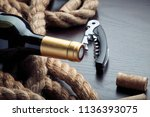 closeup of a bottle of red wine ... | Shutterstock . vector #1136393075