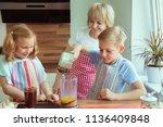 happy grandmother with her... | Shutterstock . vector #1136409848