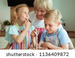 happy grandmother with her... | Shutterstock . vector #1136409872