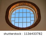 the oval window framed by the...   Shutterstock . vector #1136433782
