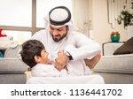 happy arabian family having fun ... | Shutterstock . vector #1136441702