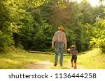 a  father and son of a cowboy | Shutterstock . vector #1136444258