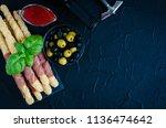 bottle of wine with corkscrew... | Shutterstock . vector #1136474642