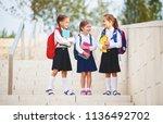 happy children girls girlfriend ... | Shutterstock . vector #1136492702