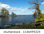 autumn inlet to cayuga lake one ... | Shutterstock . vector #1136495225