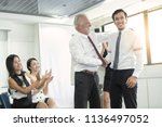 senior boss or ceo promoting... | Shutterstock . vector #1136497052