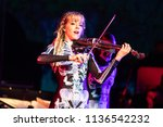 Small photo of Clarkston, MI / USA - July 9, 2018: Lindsey Stirling, on tour with Evanescence, performs at DTE Energy Music Theatre.