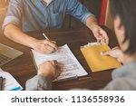 bribery  a man giving bribe...   Shutterstock . vector #1136558936