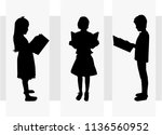 the child is reading a book. | Shutterstock .eps vector #1136560952