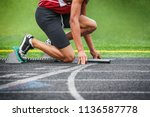 runner on the starting line of... | Shutterstock . vector #1136587778