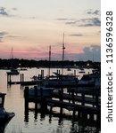 sunset at the docks | Shutterstock . vector #1136596328