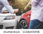 two drivers man arguing after a ... | Shutterstock . vector #1136643458