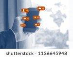 businessman hand holding mobile ... | Shutterstock . vector #1136645948