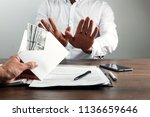 hand with envelope and us...   Shutterstock . vector #1136659646