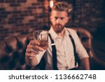 Small photo of Stylish macho classic bracers suspenders accessory close up concept. Handsome attractive elegant stunning serious resting relaxing having weekend gigolo offering you to drink with him
