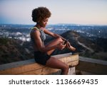 athletic african american woman ... | Shutterstock . vector #1136669435