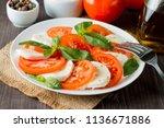 close up photo of caprese salad ... | Shutterstock . vector #1136671886