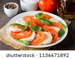 close up photo of caprese salad ... | Shutterstock . vector #1136671892