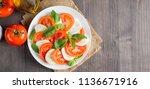 close up photo of caprese salad ... | Shutterstock . vector #1136671916