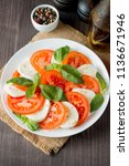 close up photo of caprese salad ... | Shutterstock . vector #1136671946