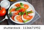 close up photo of caprese salad ... | Shutterstock . vector #1136671952