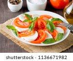 close up photo of caprese salad ... | Shutterstock . vector #1136671982