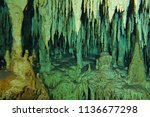 cenote stalactites and columns. ... | Shutterstock . vector #1136677298