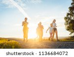 playful family running and... | Shutterstock . vector #1136684072