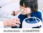 pediatrician using respiratonic ... | Shutterstock . vector #1136685905