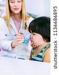 pediatrician using asthma... | Shutterstock . vector #1136686895