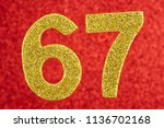 number sixty seven gold color... | Shutterstock . vector #1136702168