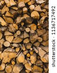 a pile of stacked firewood ... | Shutterstock . vector #1136717492