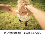 happy child swinging spinning... | Shutterstock . vector #1136737292