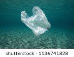 plastic waste underwater  a... | Shutterstock . vector #1136741828