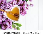 honey with acacia blossoms on a ... | Shutterstock . vector #1136752412
