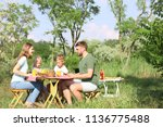 happy family having lunch at... | Shutterstock . vector #1136775488