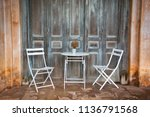 table and chairs an open... | Shutterstock . vector #1136791568
