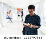 a student from india stands... | Shutterstock . vector #1136797565