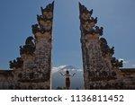 woman in bali gates volcano... | Shutterstock . vector #1136811452