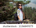 young girl in a field looking... | Shutterstock . vector #1136849375