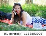 woman lying on grass outdoor ... | Shutterstock . vector #1136853008