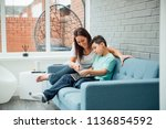 little boy and his mother are... | Shutterstock . vector #1136854592