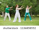 group of people practice tai... | Shutterstock . vector #1136858552